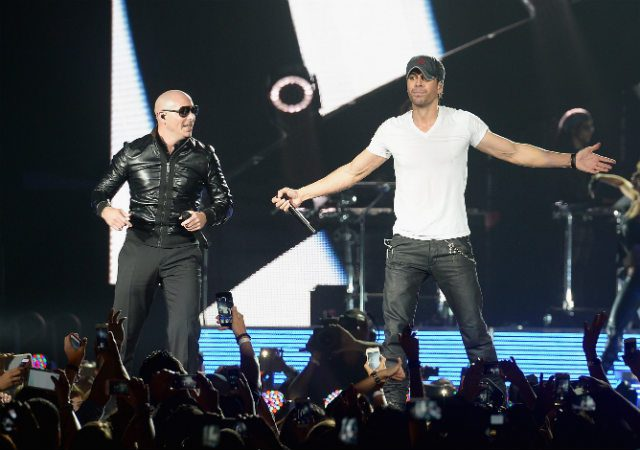 MIAMI, FL – OCTOBER 26: Pitbull and Enrique Iglesias perform at American Airlines Arena on October 26, 2014 in Miami, Florida. (Photo by Gustavo Caballero/Getty Images)