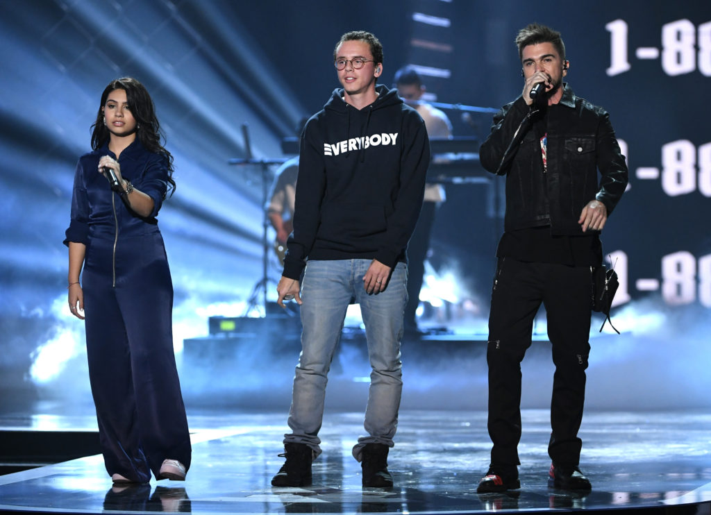 LAS VEGAS, NV - NOVEMBER 16: (L-R) Alessia Cara, Logic, and Juanes perform onstage at the 18th Annual Latin Grammy Awards at MGM Grand Garden Arena on November 16, 2017 in Las Vegas, Nevada. (Photo by Kevin Winter/Getty Images)