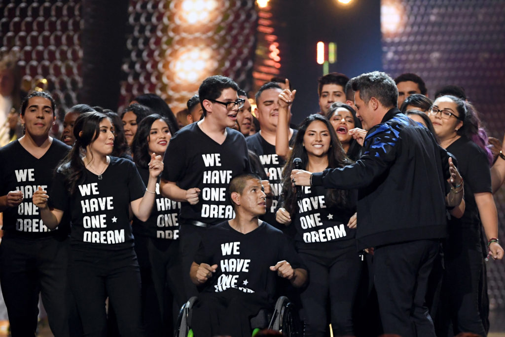 LAS VEGAS, NV - NOVEMBER 16: Honoree Alejandro Sanz (R) performs with a group of 'DREAMers' onstage at the 18th Annual Latin Grammy Awards at MGM Grand Garden Arena on November 16, 2017 in Las Vegas, Nevada. (Photo by Kevin Winter/Getty Images)